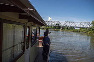 On the river tram in the direction of the railway bridge across the Urals